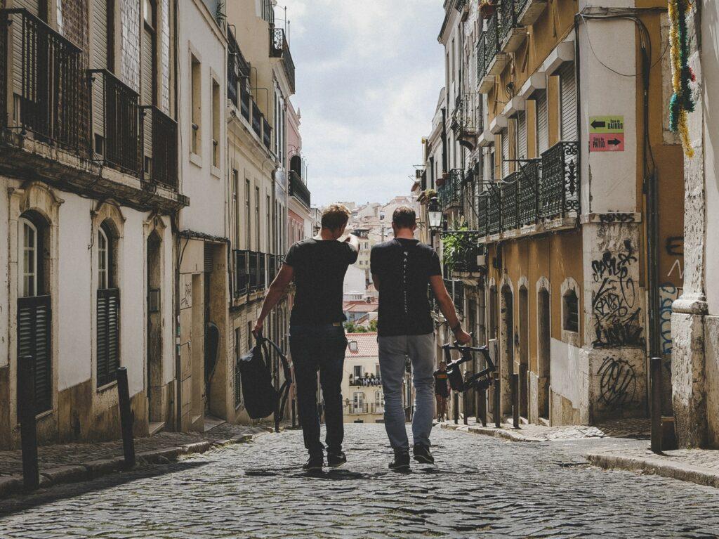 two friends walking on a street