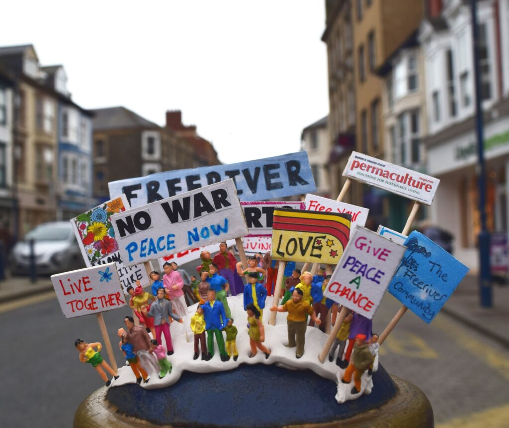 miniatures with placards