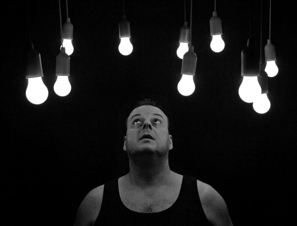 man starring at bulbs