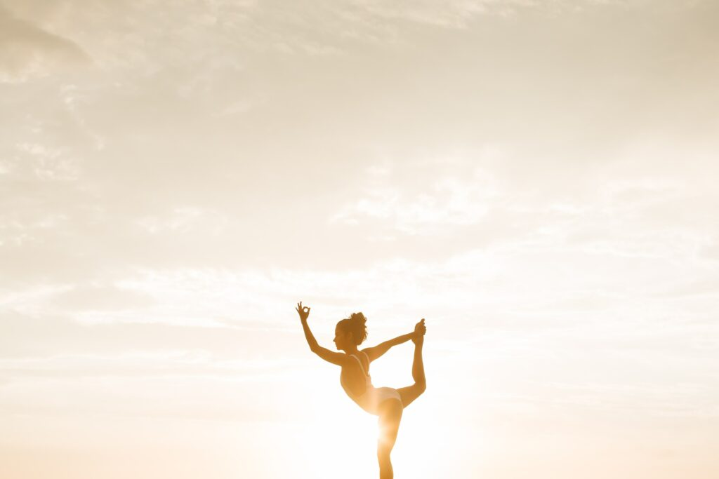 yoga pose with sun in background